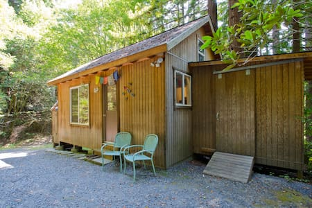 This is a place to unplug and just be surrounded by nature. It is a comfortable cabin but also has an outdoor shower only. There is only one queen futon sofa bed to accommodate (2) adults. This Property is not available for children or animals.