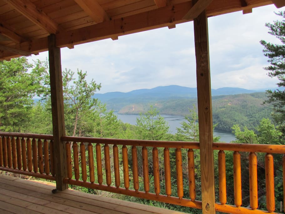 Covered 8' x 32' deck overlooks Chilhowee Lake and the western peaks of the Smoky Mtn Natl Park.