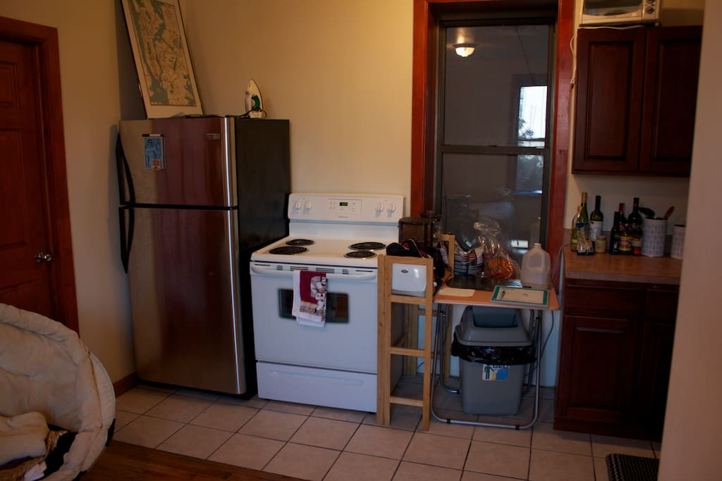 This is a picture of our kitchen from the view of the futon.