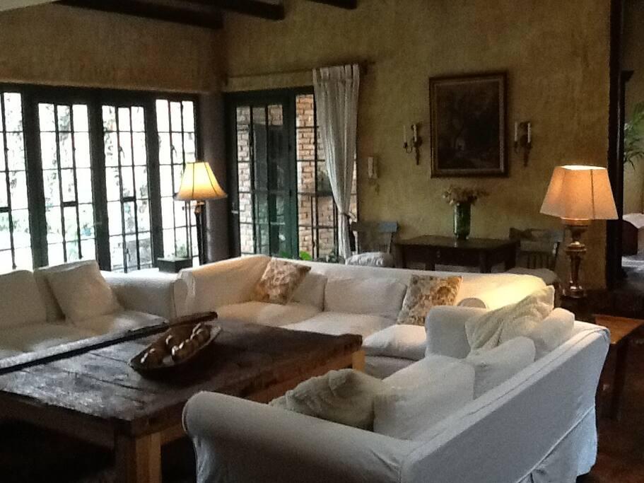 Comfortable sala seating with views of gardens
