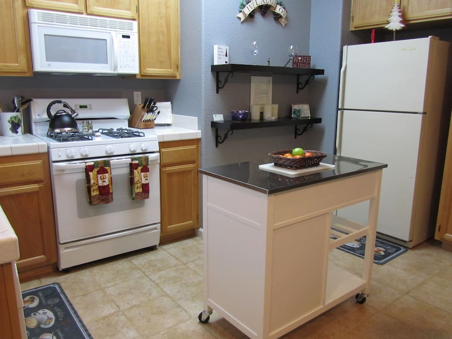 A full-sized kitchen fully equipped - fridge, microwave, stove/oven, dishwasher.