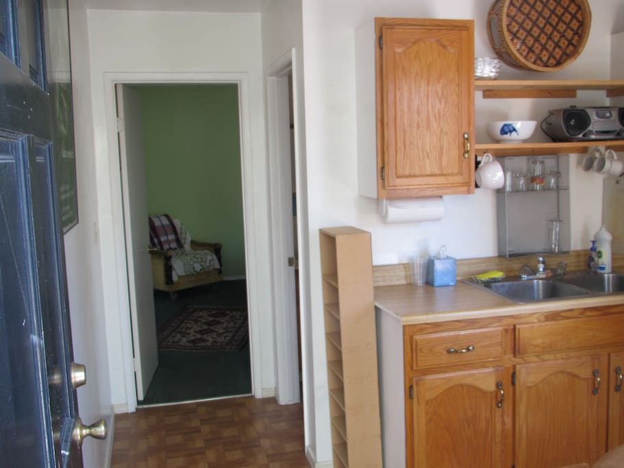View from the front door into the kitchen and hall way into bedroom and bathroom