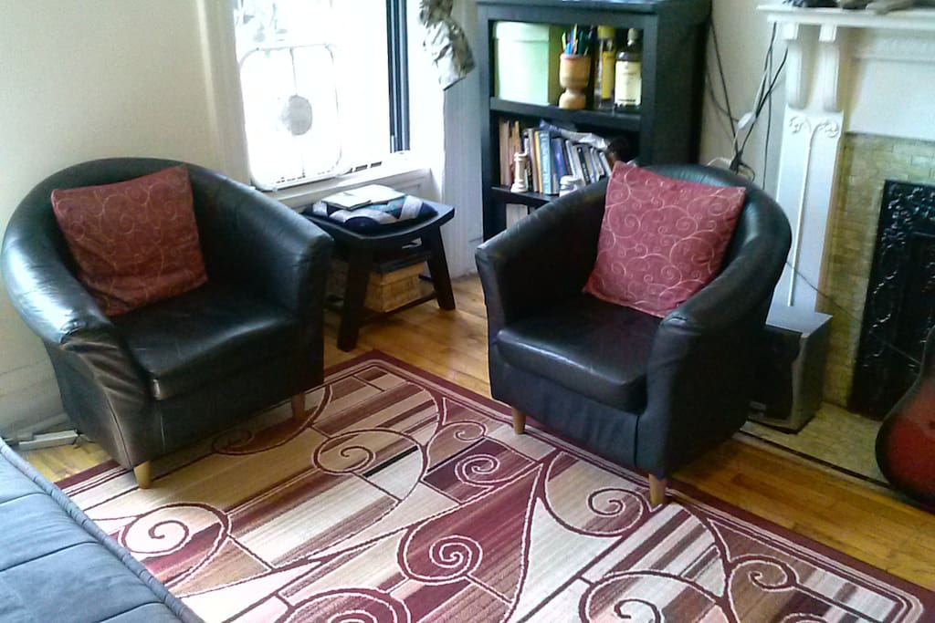 There is also a seating area near the window for reading. See the nice hardwood floors?