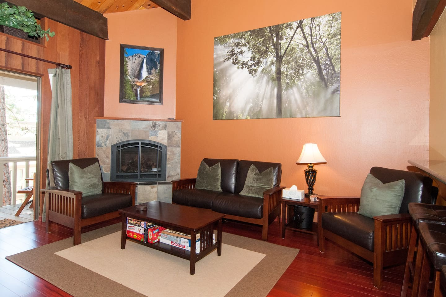 Great room with beautiful authentic redwood paneling and a cozy fireplace