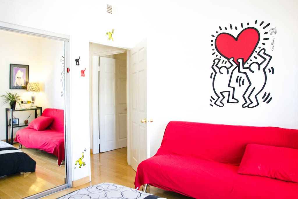 Guest Room - The giant art up on the wall is a Keith Haring wall decal; you'll see from our apartment that we have an eclectic taste in art.