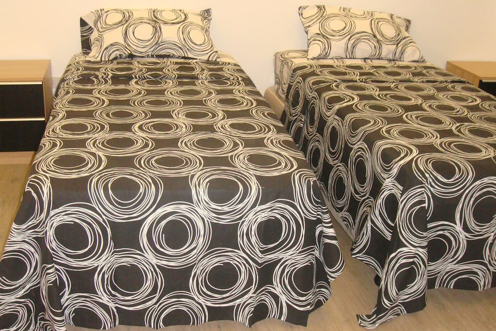 Large bedroom with twin single beds with sprung mattresses and aircon