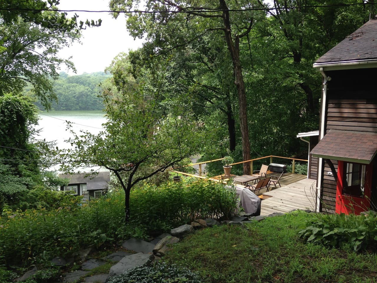 View from driveway, down to house & deck, then boathouse/dock