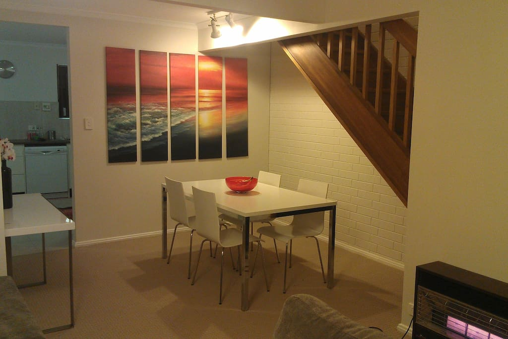 Downstairs dining area through to kitchen