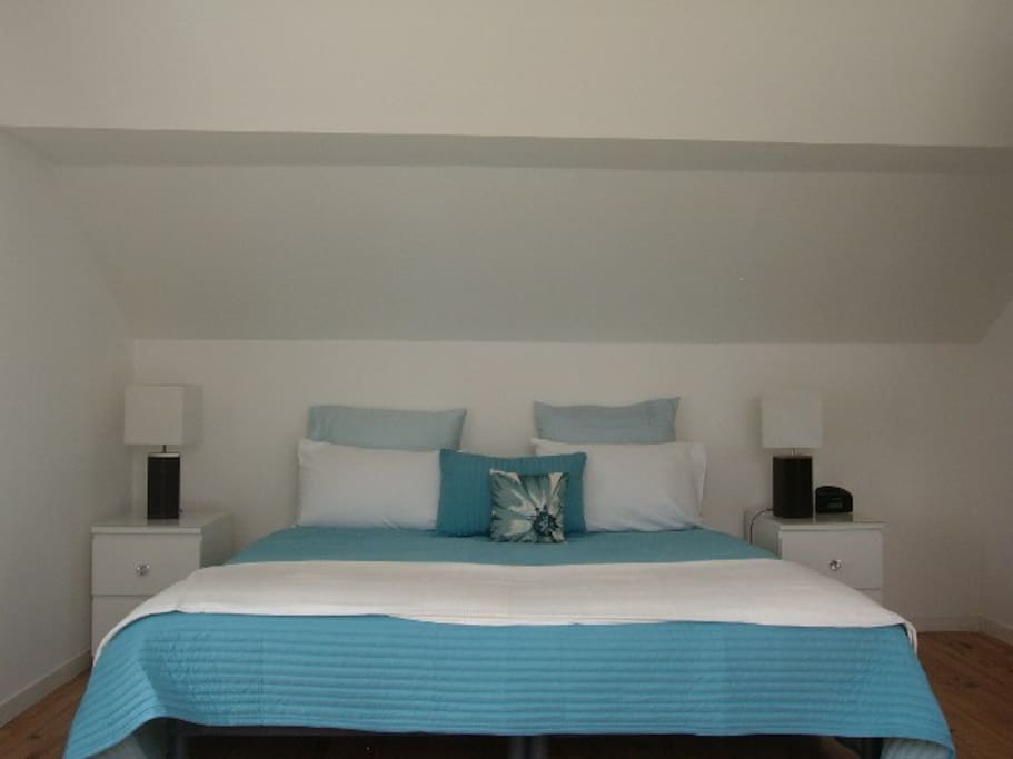 Large comfortable double bed with quality linen