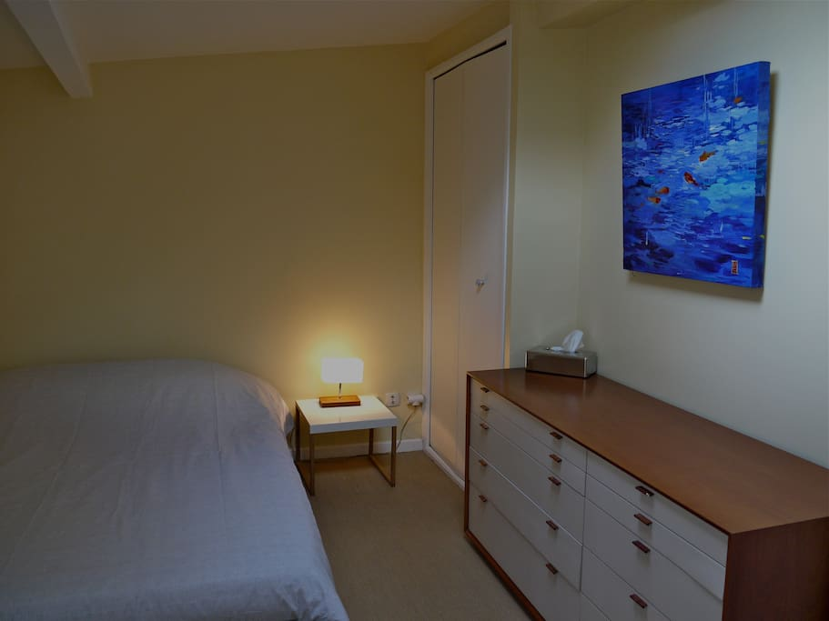 second level bedroom with double bed and skylight