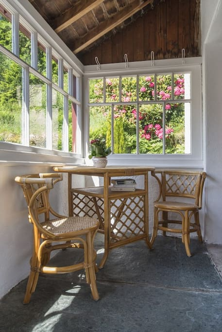 The sunny porch is a nice place to sit, but also great for drying waterproofs and walking boots.