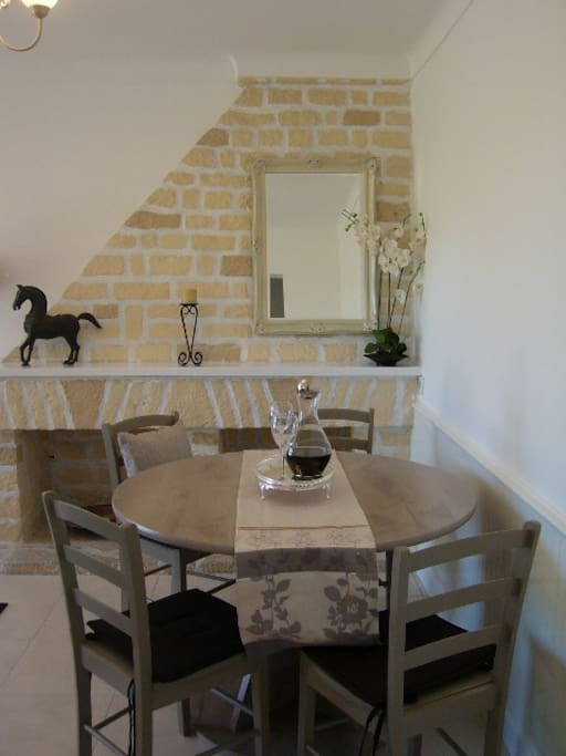 dining area with lovely stone fireplace