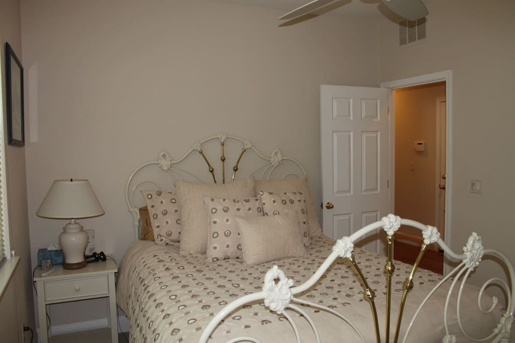 Queen bedroom with brass bed with lots of closet space.