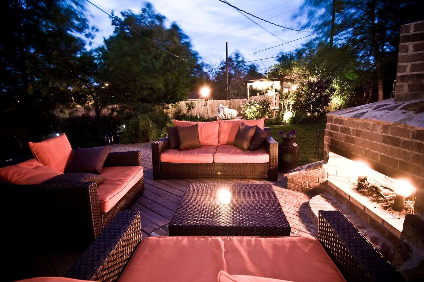 The back garden seating area and outside fireplace