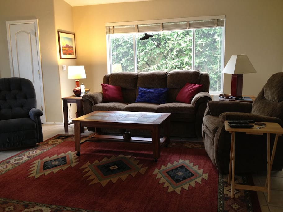 Enjoy my bright, open family room with reclining couch and chairs.