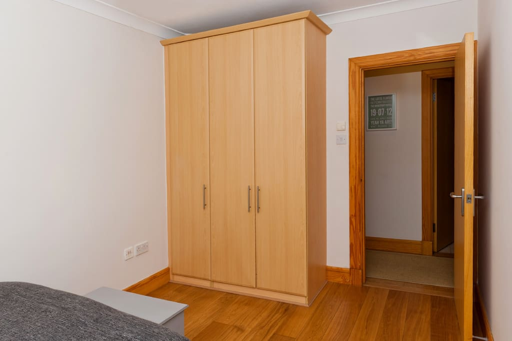Large double wardrobes with shelving in your private bedroom