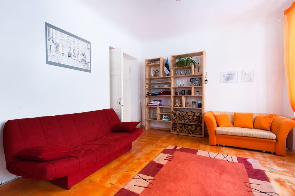 Orange bed-sofa for 2 people.