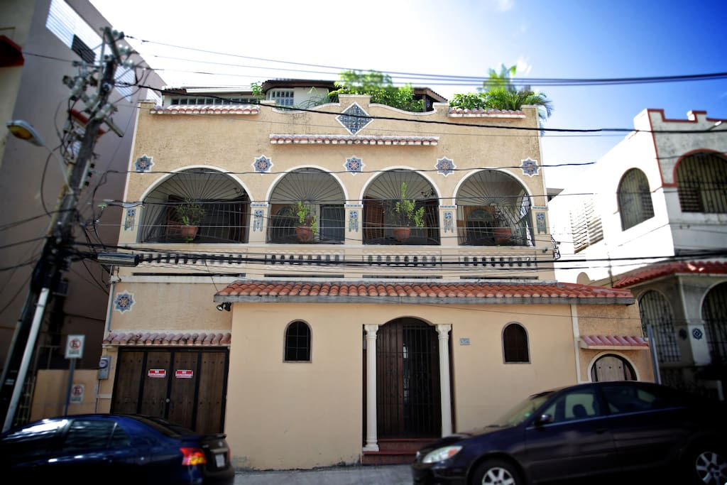 Historic house was originally built in 1915 as a one level house and expanded in the late 1920's to add second floor with arched balcony and mosaics typical of 'Santurce' architecture.