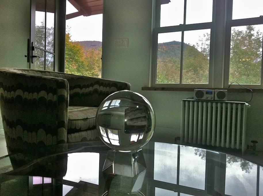 Detail of living area, with crystal ball, vintage chairs, great view and south light.