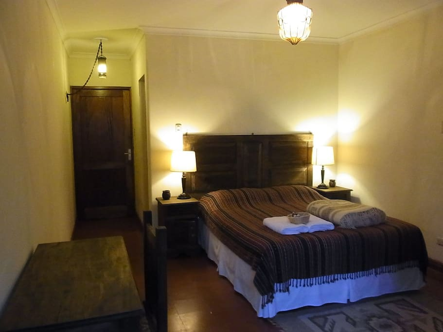 Bedroom with Queen Size Bed and a Desk