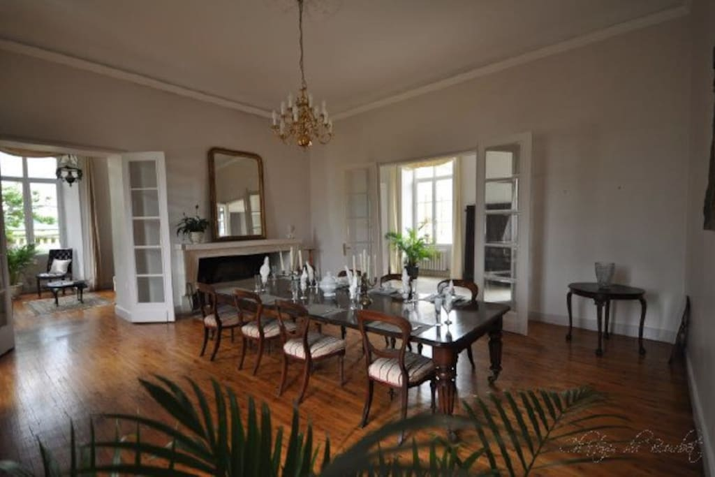 The dining room, with its beautiful open fireplace, comfortably seats 12 people.