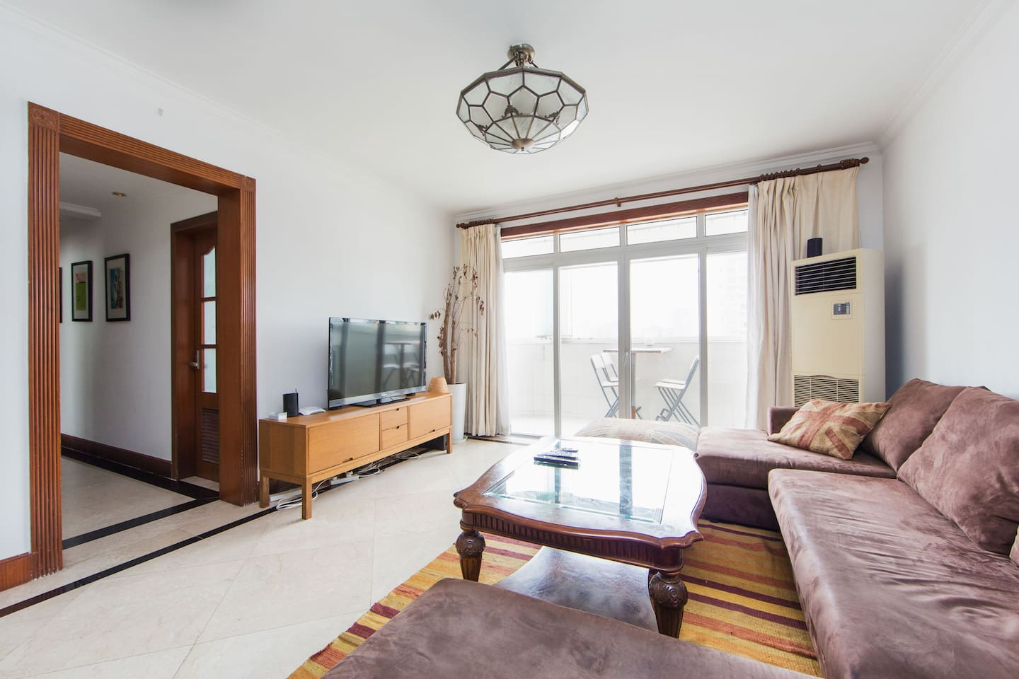 modern open plan living and diing room, leading to 24th floor terrace