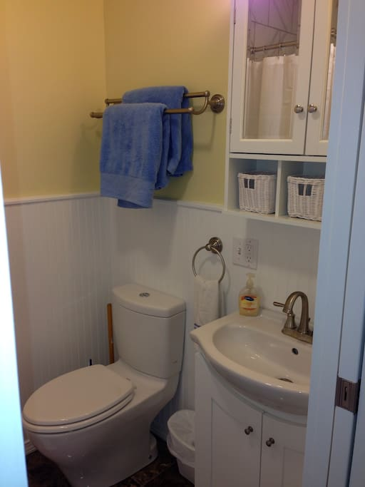 Our newly renovated bathroom, marble floors, cast iron tub, tiled shower walls, new toilet and sink.
