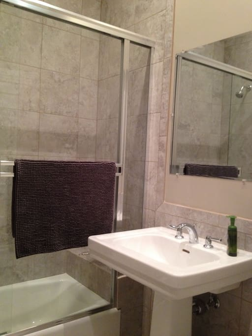 Great Shower Head, Great Water Pressure & Water Heater on Demand, so you'll always have a HOT shower! Full high ceilings!