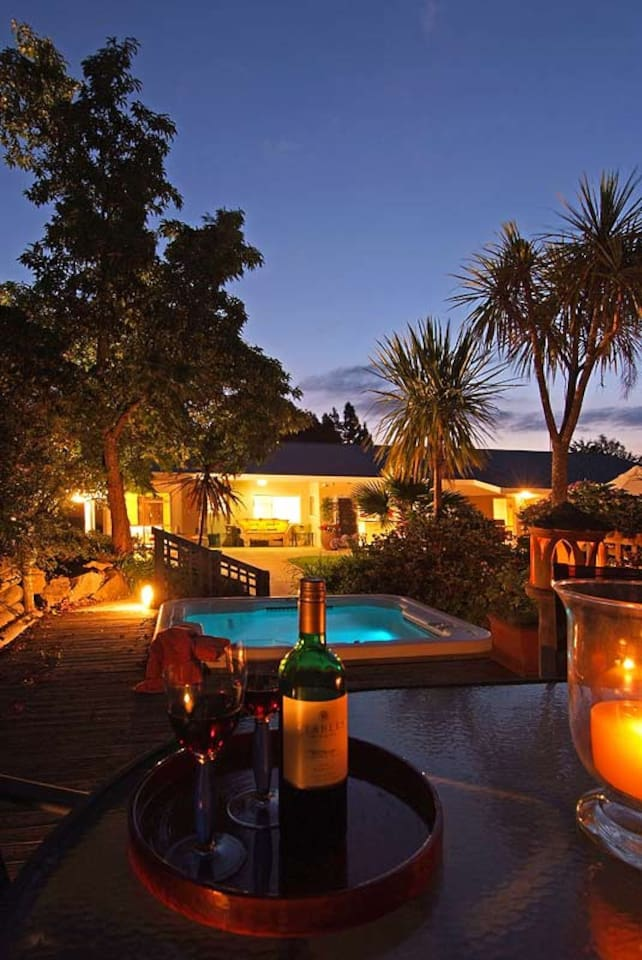 Outdoor hot tub and evening wine, warm and relaxing.