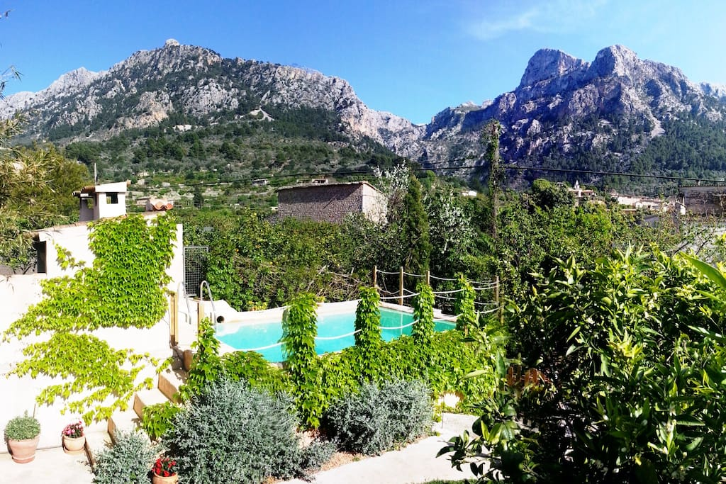 the swim pool in the garden, with fantastic views of the mountains.