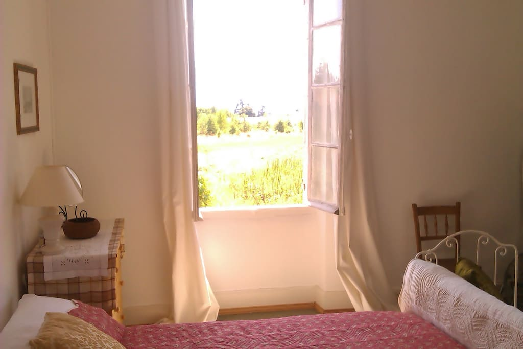 The main double bedroom is a light and airy room with two large windows.
