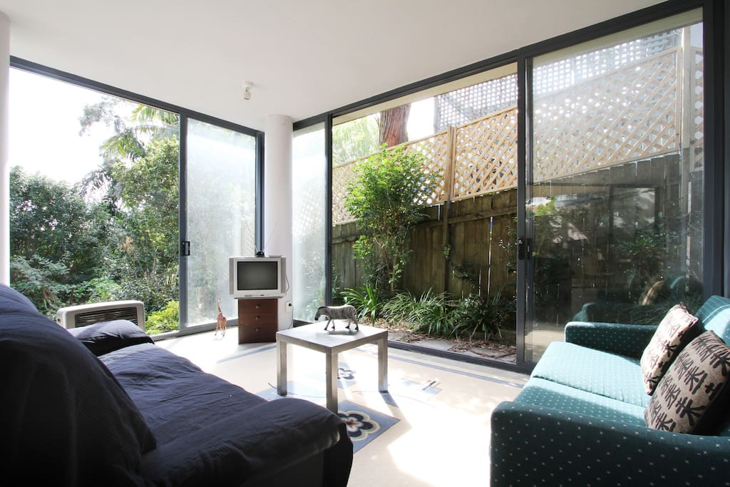 Lounge room has large glazed sliding doors to catch the cooling north east breezes in the summer.