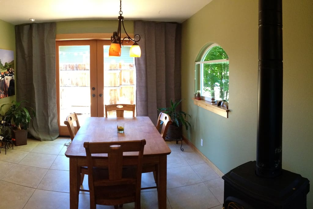 Dining room (table seats 8) with french door access to backyard; outdoor deck with patio furniture and grill