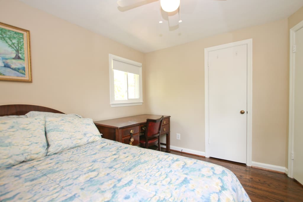 Bedroom with Queen bed and desk and a dresser