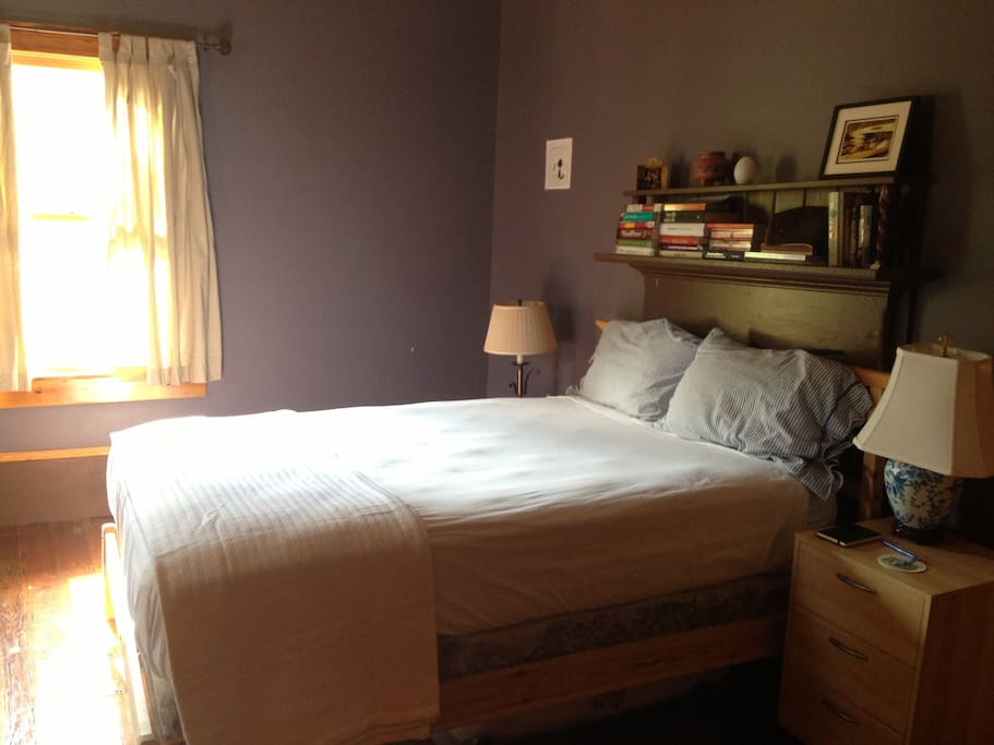 Cozy full-sized bed with pillow-top mattress.