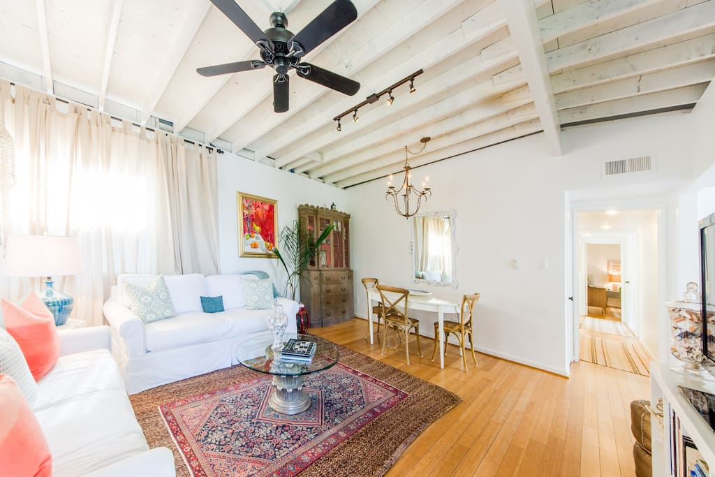 The exposed beam ceilings give the living room the feel of an old-school Venice bungalow