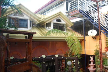 Your home&family in a distant shore - Surigao City
