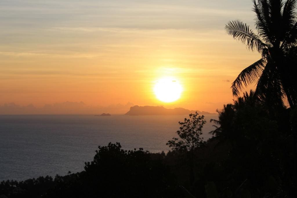 The sun setting above the island of Koh Phangan one of the many islands visible from El Cid Villa!