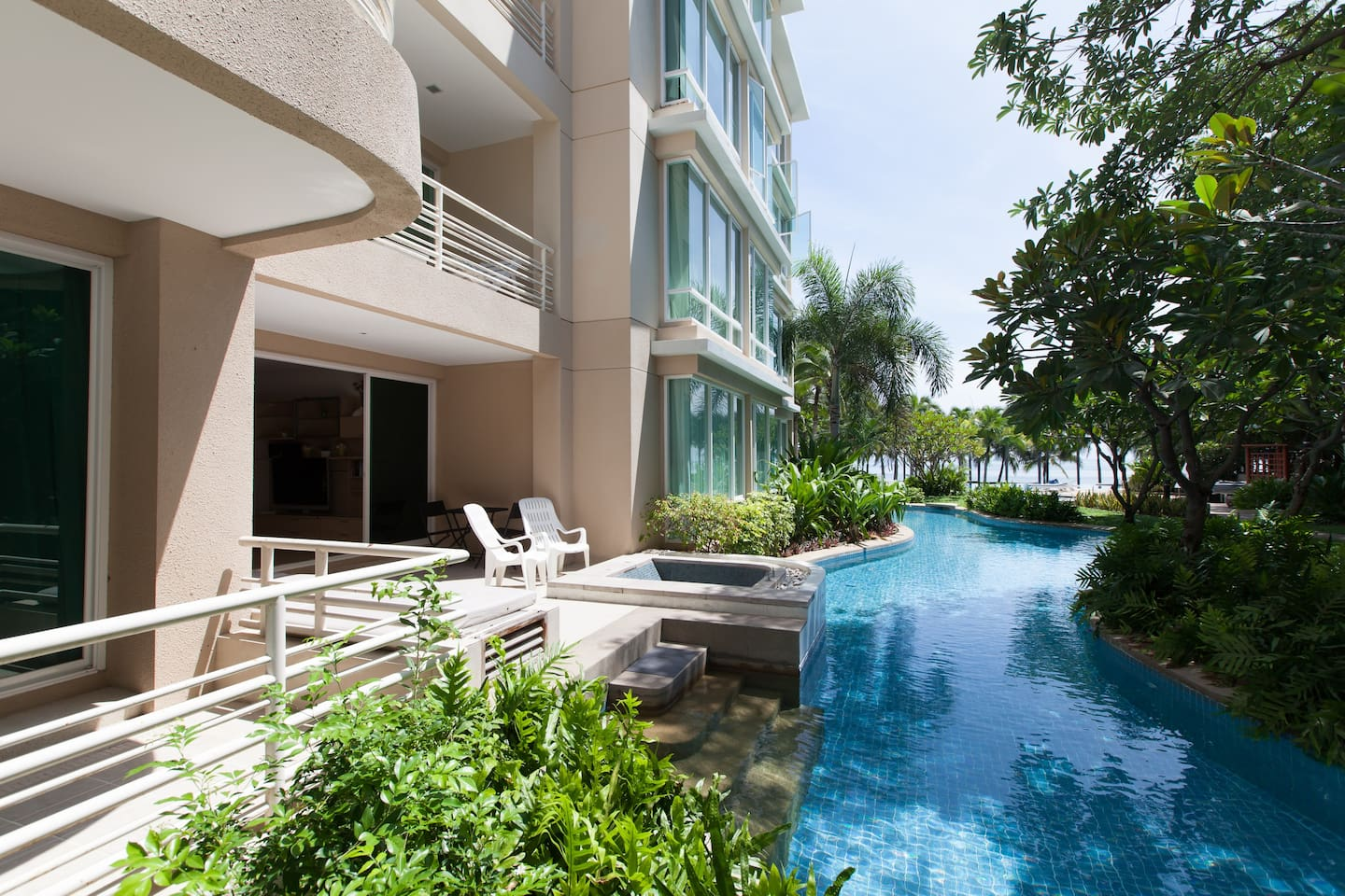 Master Bedroom and living room's balcony with private jacuzzi and ditect pool access. First building from the beach.