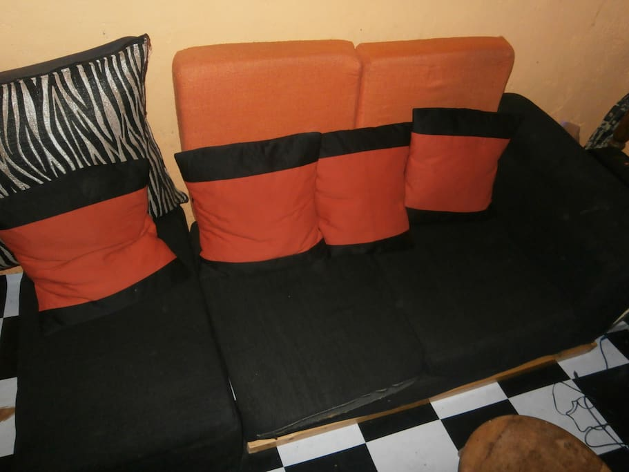 inside the hut two seater couch
