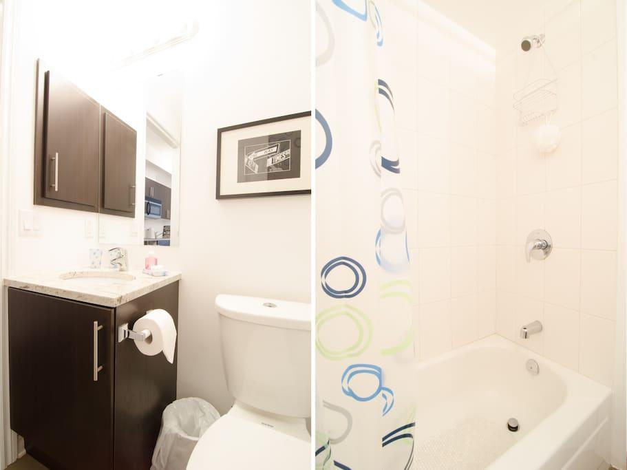 Bathroom has medicine cabinet, granite counter top, ceramic flooring and bath tub