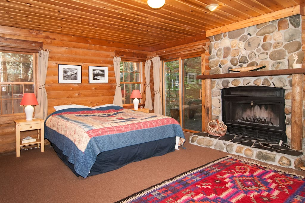 Master bedroom - with wood-burning fireplace, king bed, sliding doors to deck and hot tub.