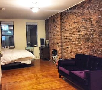 This charming brick wall Greenwich Village apartment is cozy, comfortable and is located on the best block and neighborhood you could ask for. Perfect for a trip alone or with someone else. Located next to the best restaurants, one block from the subway and one block from Washington Square Park.