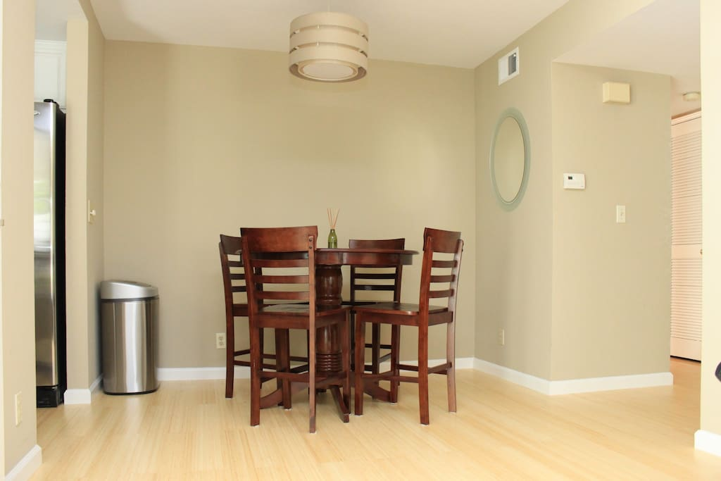Dining area with high chair stylish dining table.