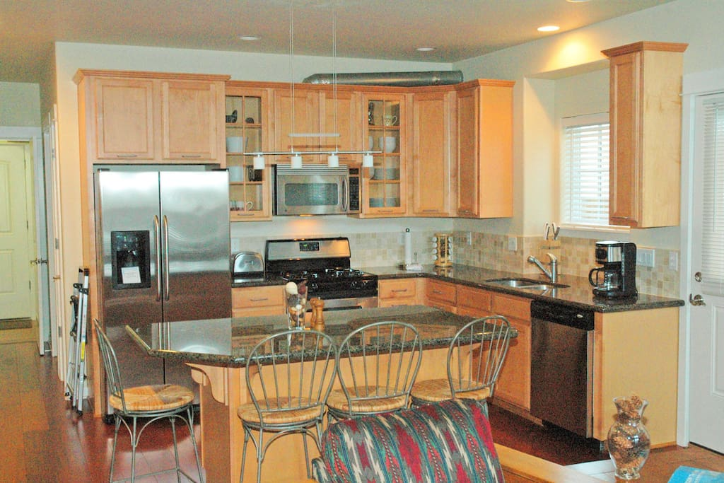 Gourmet kitchen with everything provided; dining area seats 10