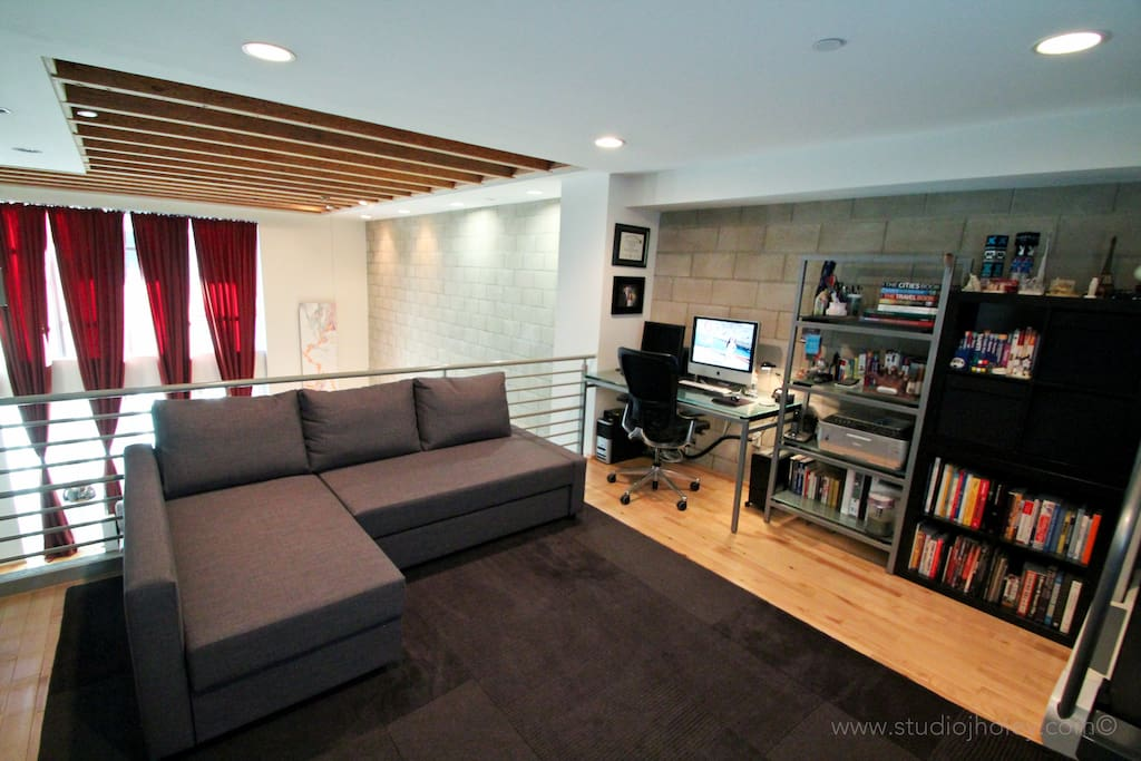Mezzanine/loft with a guest bed (sleeps 2 here- open to below)