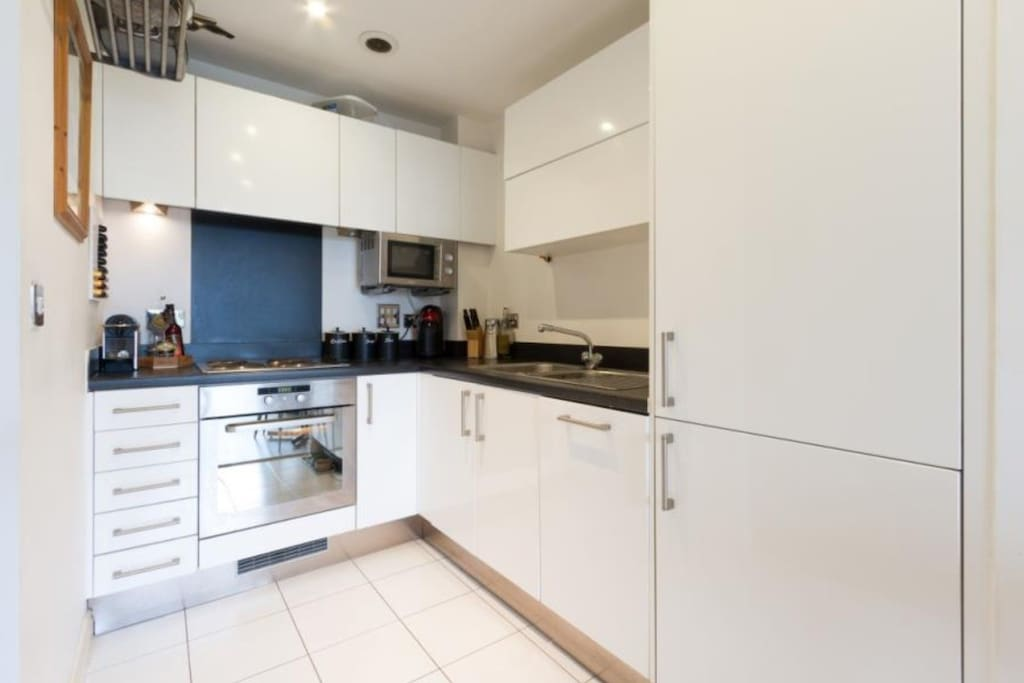 Kitchen - fully equipped with plates pans and cutlery