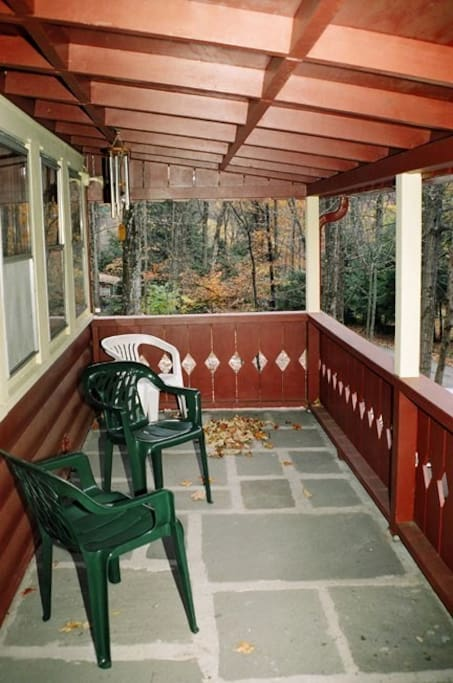 The front porch, now with a sofa, is a good place to sip wine and soak in the breeze or the rain.