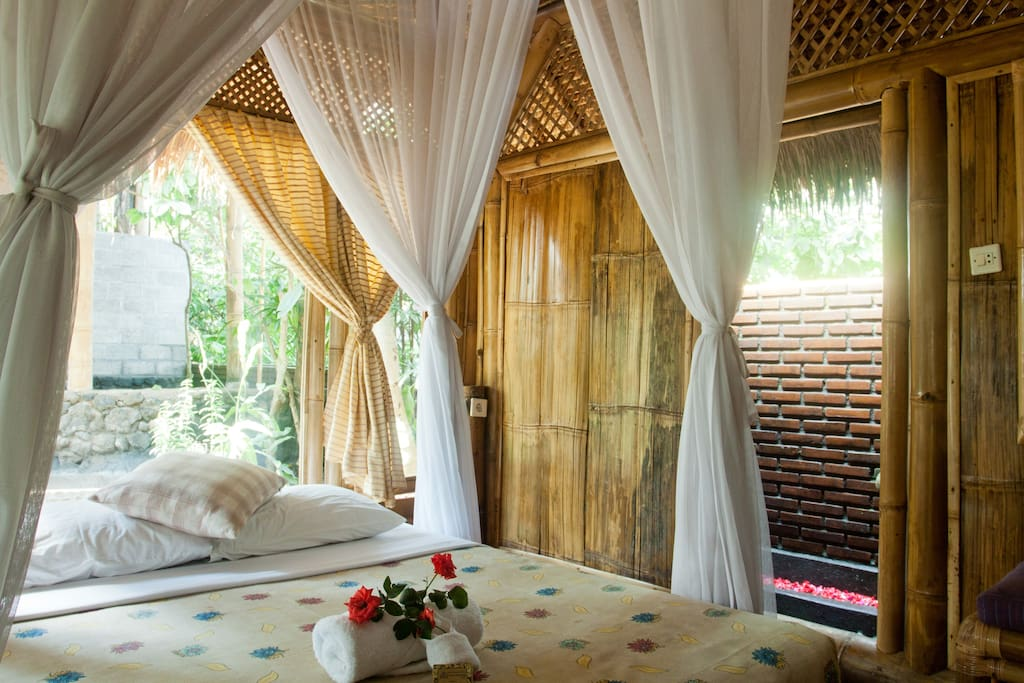 1 Queen-Size Bed with Mosquito Net per Room