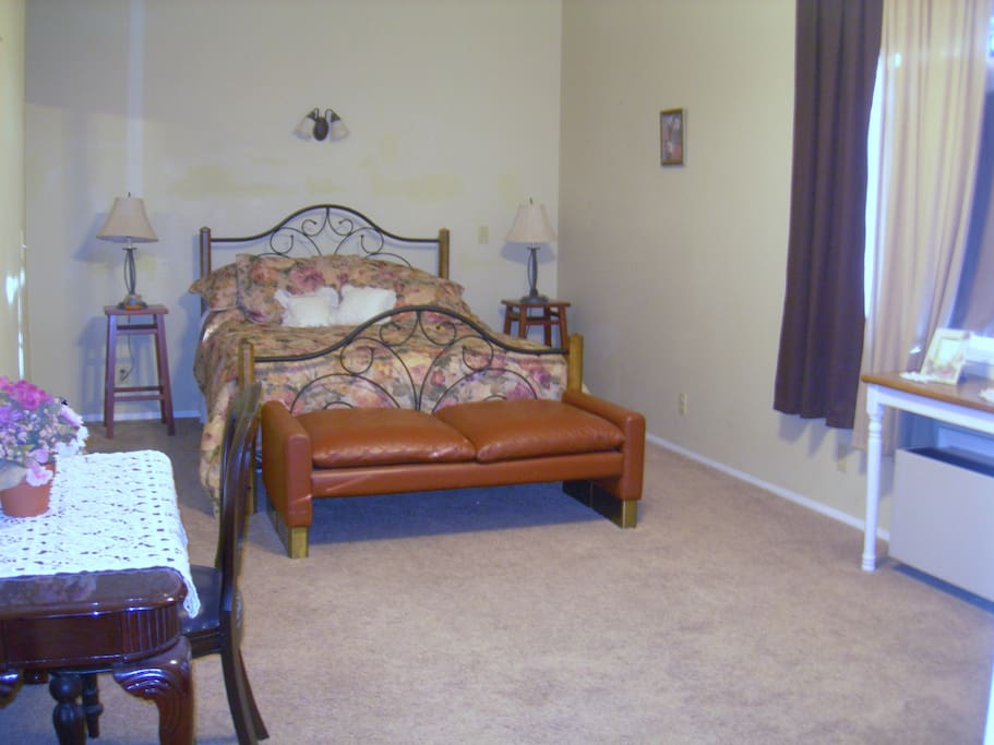 This is a more current picture of the master bedroom downstairs. There is a hugh walk-in closet with mirror doors.